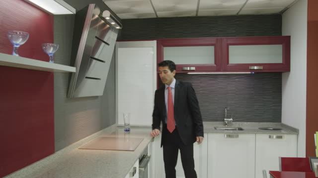 POV TS salesman showing kitchen furniture in showroom