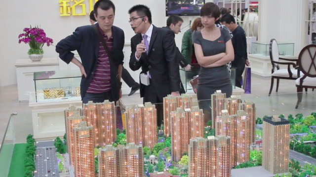 MS Salesman talking with customer in housing exhibition/xian,shaanxi,China