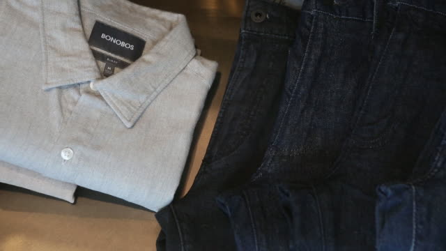 salespeople help shoppers look for clothes in a bonobos guide shop in greenwich connecticut us on sunday october 21 2018 - schottenkaro stock-videos und b-roll-filmmaterial