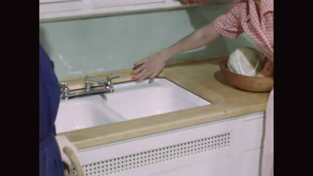 cu saleswoman shows kitchen sink to customer / united states - open house stock videos & royalty-free footage