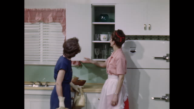 ms saleswoman shows kitchen to customer / united states - open house stock videos & royalty-free footage