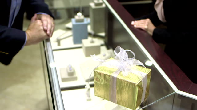 saleswoman shows rings to man in jewelry store - display cabinet stock videos & royalty-free footage