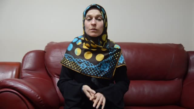 stockvideo's en b-roll-footage met saliha aydin, a victim of turkey's 1997 'postmodern' coup speaks at an interview on february 22, 2018 in kutahya, turkey. the victims of turkey's... - politics and government
