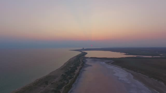 aerial: saline land between the sea and salt lakes - backwater stock videos & royalty-free footage