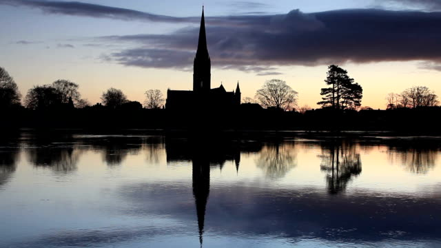 salisbury cathedral and the west harnham water meadows. - circa 13th century stock videos & royalty-free footage