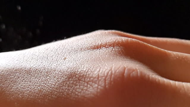 saliva droplets falling on back of hand, covid-19 - skin stock videos & royalty-free footage