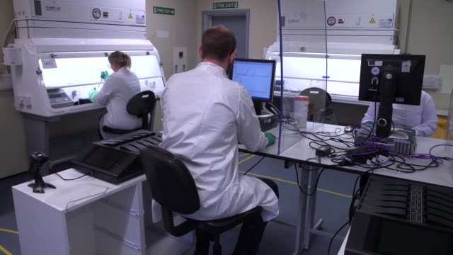 saliva sample being tested in a laboratory for coronavirus - scientific experiment stock videos & royalty-free footage
