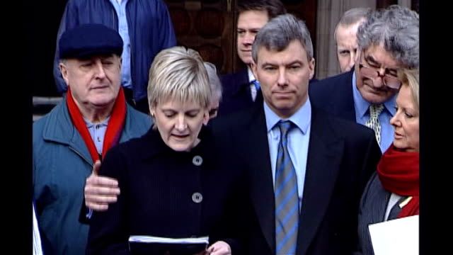 High Court EXT Sally Clark out of court with husband Stephen Clark and legal team at time of winning her appeal Press Sally Clark statement to press...