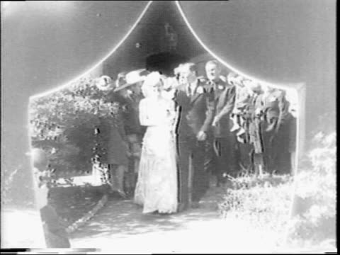 sally rand weds thurkel 'turk' greenough / married couple walk out of church / bride and groom shake hands with friends / bride walking forward /... - burlesque stock videos & royalty-free footage
