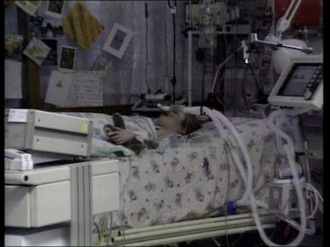 sally slater has heart transplant england newcastle freeman hospital ms six year old sally slater lying on bed in intensive care ward attached to... - hand on heart stock videos & royalty-free footage
