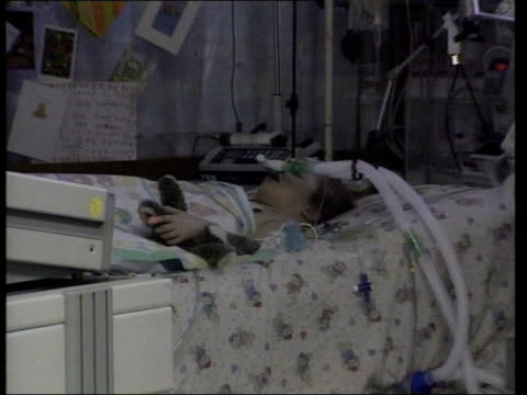 sally slater has heart transplant; int six year old sally slater lying on bed in intensive care ward attached to ventilator zoom in cms sally lying... - respiratory machine stock videos & royalty-free footage