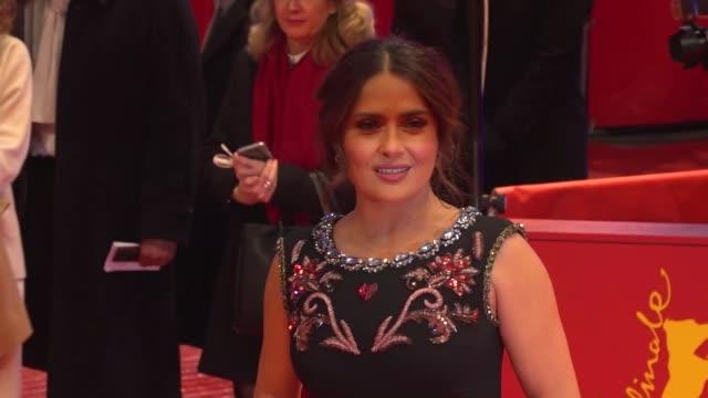 salma hayek, actress, on working with one of her best friends, javier bardem, on 'the roads not taken' 70th berlin international film festival,... - salma hayek stock videos & royalty-free footage