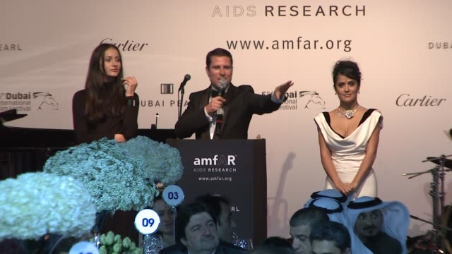 salma hayek auctions an engraved cartier wrist band at the 2008 dubai international film festival amfar auction and dinner at dubai - engraved image stock videos and b-roll footage