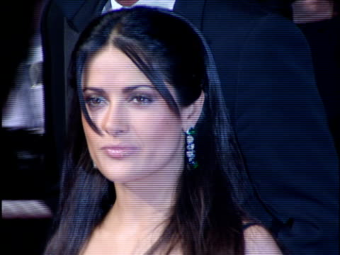 salma hayek looking side to side as she moves along red carpet posing for pictures - salma hayek stock videos & royalty-free footage