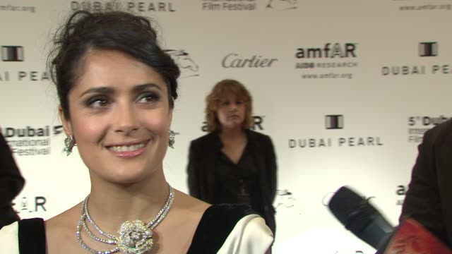 stockvideo's en b-roll-footage met salma hayek on her connection to amfar and aids organisations on her lots in the auction and what she's wearing tonight at the 2008 dubai... - merknaam