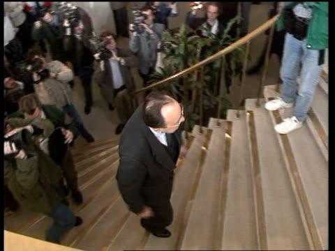salman rushdie affair: eec withdraws diplomats from iran; d) belgium: brussels: berlaymont: ec hq: int sir geoffrey howe r-l as looking at watch past... - desk stock videos & royalty-free footage