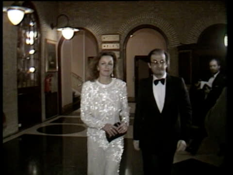 salman rushdie and wife marianne wiggins attending evening reception event walking past cameras an up steps - shock tactics stock videos and b-roll footage