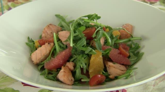 salmon, citrus fruit and rocket salad - salmon salad stock videos & royalty-free footage