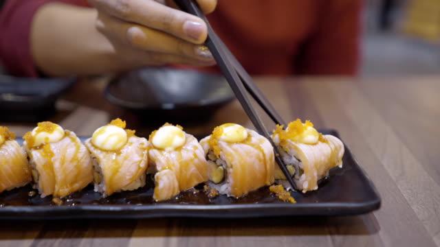 salmon maki roll. - nigiri stock videos and b-roll footage