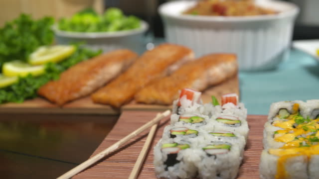 salmon move to sushi on table close up - steak plate stock videos & royalty-free footage