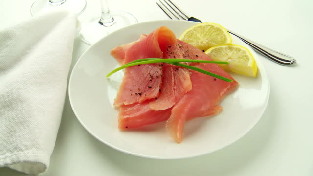 salmon rotates on white plate with lemon & dill - dill stock videos and b-roll footage