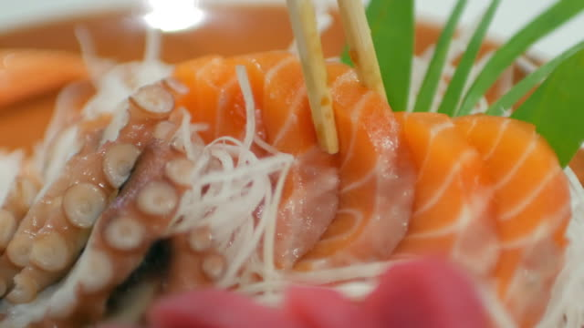 salmon sashimi bar japanese food at japanese restaurant , 4k(uhd) - toro fish stock videos and b-roll footage