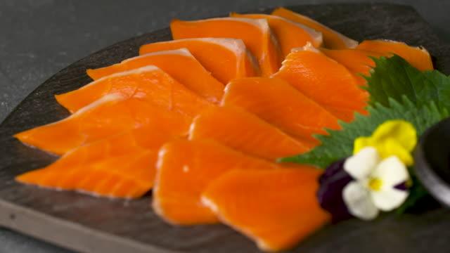 vídeos de stock, filmes e b-roll de salmon sashimi in the plate / south korea - sashimi
