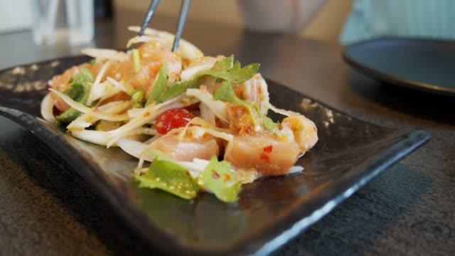 salmon sashimi spicy salad on black dish in the restaurant.japanese food style - salmon salad stock videos & royalty-free footage