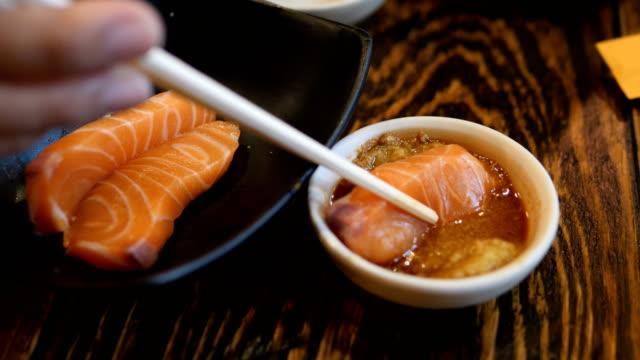 salmon sashimi - wasabi sauce stock videos and b-roll footage