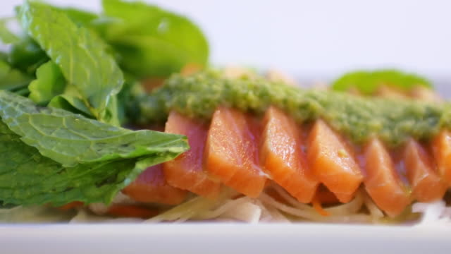 salmon sashimi with wasabi and spicy sauce - wasabi sauce stock videos and b-roll footage