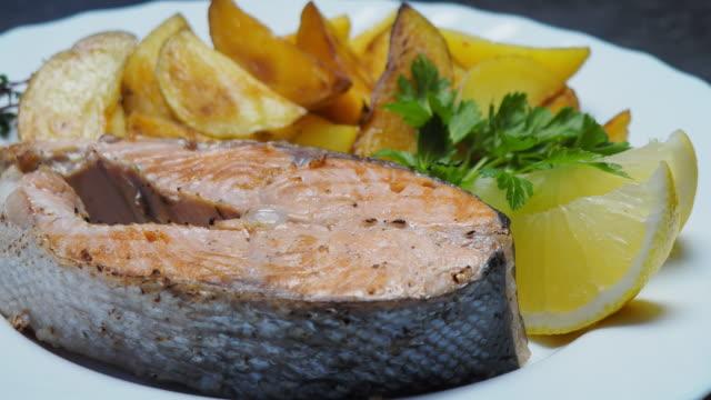 salmon steak and chips - salmon steak stock videos & royalty-free footage