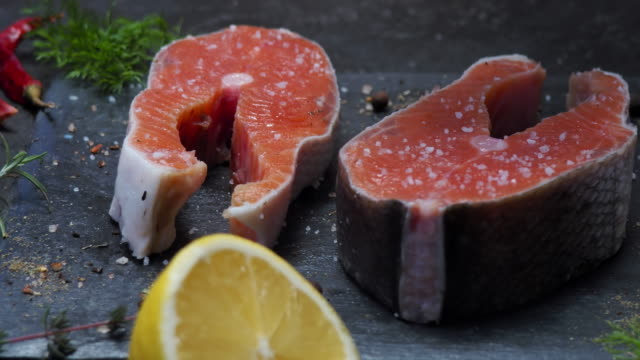 salmon steaks salting - adding salt stock videos and b-roll footage