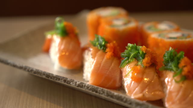 salmon sushi and salmon maki - japanese food stock videos & royalty-free footage