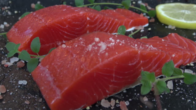 salmon with sea salt and fresh herbs - filleted stock videos & royalty-free footage