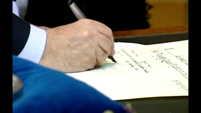 salmond ratified as first minister scotland edinburgh int alex salmond taking oath and signing documents at swearingin ceremony before a panel of... - alex salmond stock videos & royalty-free footage