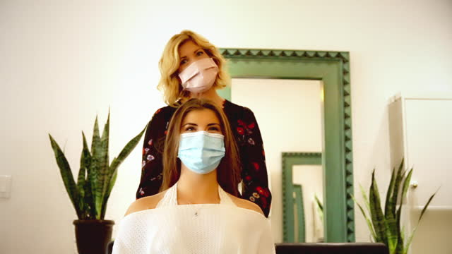 salon visit during quarantine: hair stylist consults with her client - straight hair stock videos & royalty-free footage