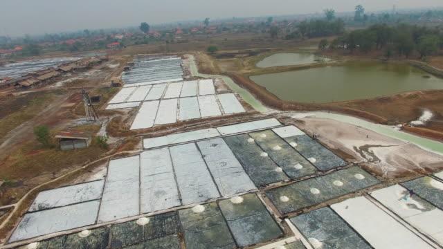 salt basins in laos salt village / laos - 農家の家点の映像素材/bロール