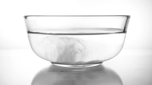 salt dissolving in warm water - bowl stock videos & royalty-free footage