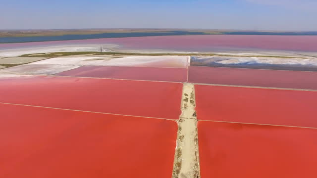 aerial: salt evaporation ponds at salt lakes - evaporation stock videos & royalty-free footage