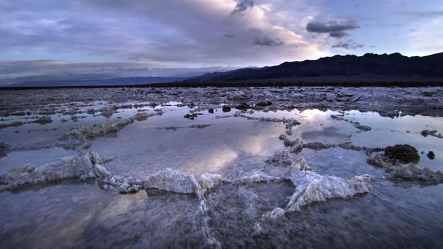 salt flats after rain, death valley national park, ca - death valley national park stock videos & royalty-free footage