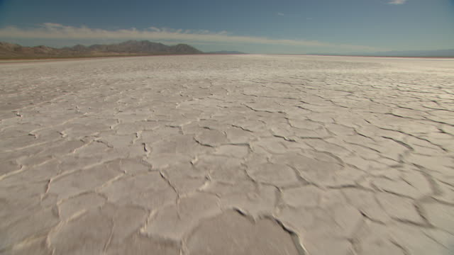 salt flats stretch across mexico's baja california desert. - salt flat stock videos & royalty-free footage