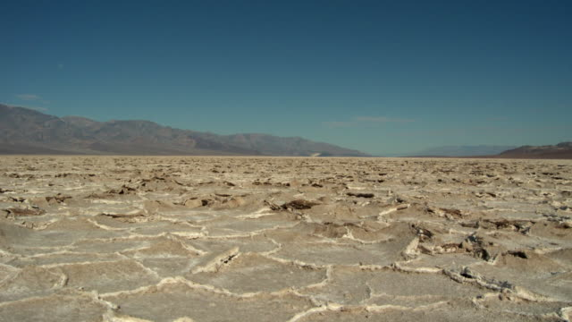 ws salt formations in badwater basin / death valley national park, california, usa - stationary process plate stock videos and b-roll footage