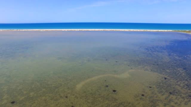 Salt lake and blue sea, aerial video