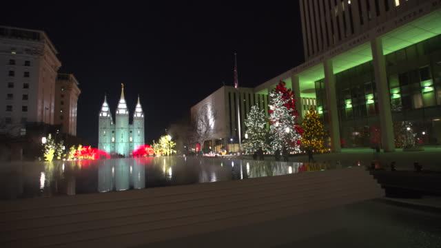 salt lake city mormon temple christmas winter pan - mormon temple stock videos and b-roll footage