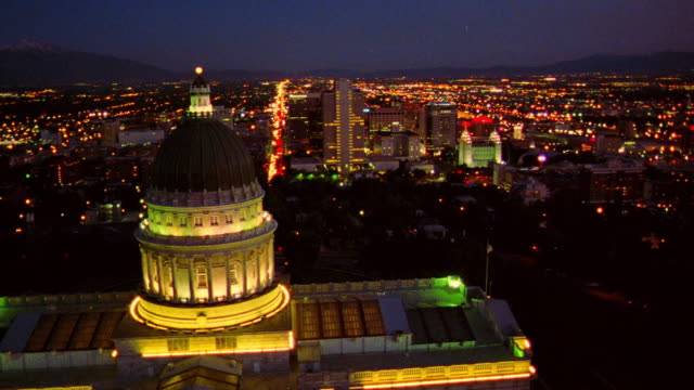 AERIAL Salt Lake City skyline at dawn/dusk with Mormon Temple, World Headquarters + Capitol Building
