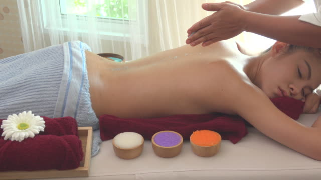 salt massage in spa - massager stock videos and b-roll footage