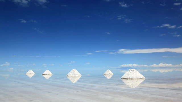 salt piles in salar de uyuni, potosi, bolivia, south america - bolivia stock videos & royalty-free footage