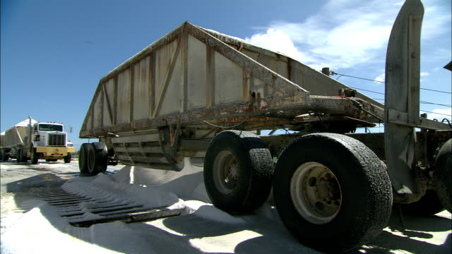 salt pours from the bottom of a semi-trailer. - mineral stock videos & royalty-free footage