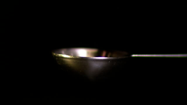 salt pours into a spoon. - spoon stock videos & royalty-free footage