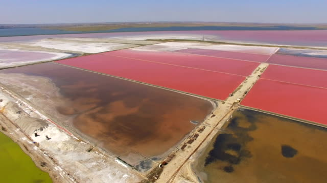 aerial: salt production in salt lakes - evaporation stock videos & royalty-free footage